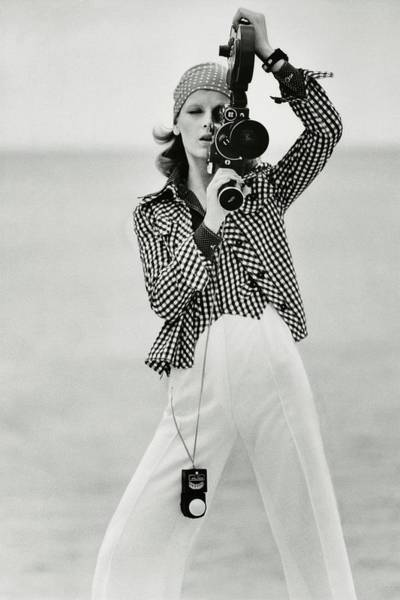 Photograph - A Model Looking Through A Beaulieu Camera Wearing by Gianni Penati