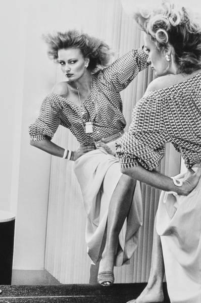 Pendant Photograph - A Model Looks Into A Mirror Wearing Donna Karan by Chris von Wangenheim