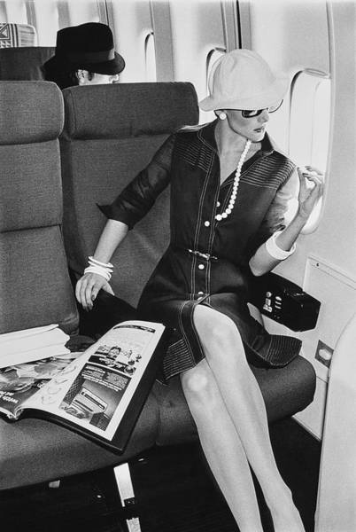 Commercial Airplane Photograph - A Model Looks Wearing Abe Schrader On An Airplane by Chris von Wangenheim