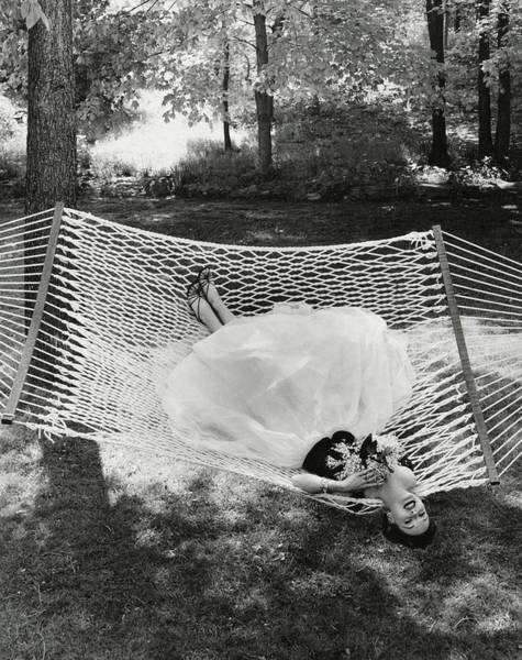 Formal Wear Photograph - A Model Lying On A Hammock by Gene Moore