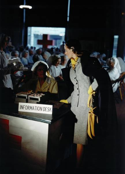 Desk Photograph - A Model Posing By An Information Desk by Horst P. Horst