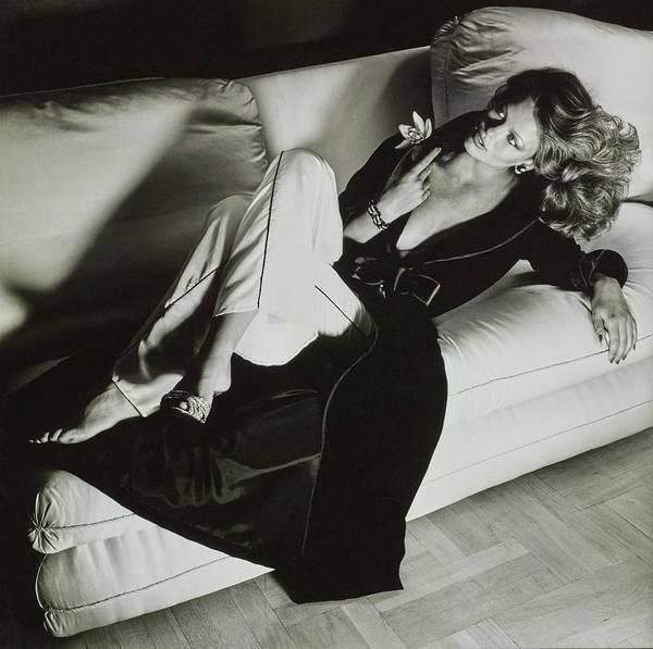 Bed Photograph - A Model Reclines On A Sofa Wearing Fernando by Chris von Wangenheim