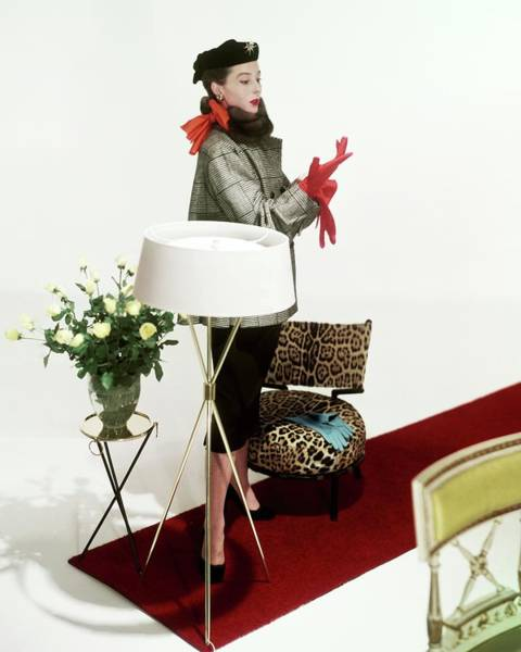 Red Flower Photograph - A Model Surrounded By Assorted Furniture On A Red by Horst P. Horst