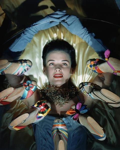 Colorful Photograph - A Model Surrounded By Sandals by Horst P. Horst