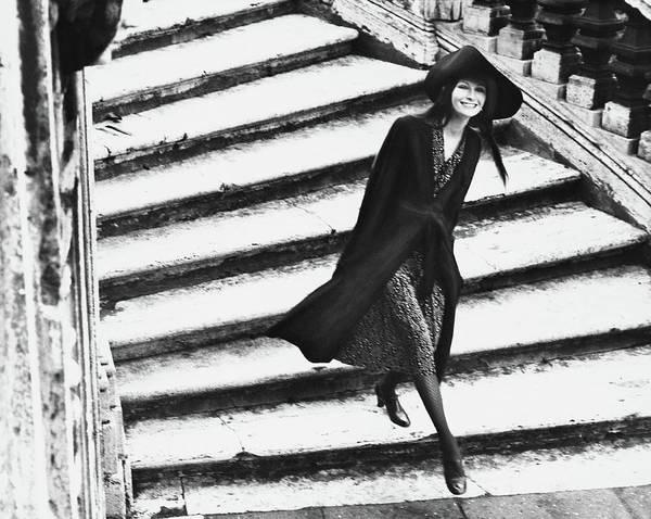 Photograph - A Model Walking Down A Staircase by Henry Clarke