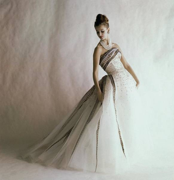 Photograph - A Model Wearing A Balmain Dress by Jerry Schatzberg