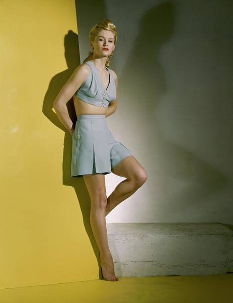 Yellow Background Photograph - A Model Wearing A Bathing Suit by Horst P. Horst