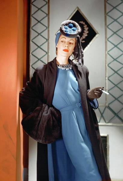 Blue Photograph - A Model Wearing A Blue Dress by Horst P. Horst