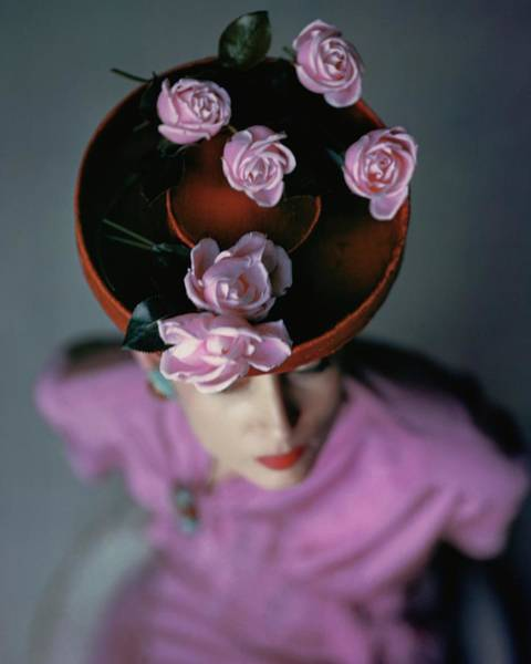 Caucasian Wall Art - Photograph - A Model Wearing A Bonwit Teller Hat by John Rawlings