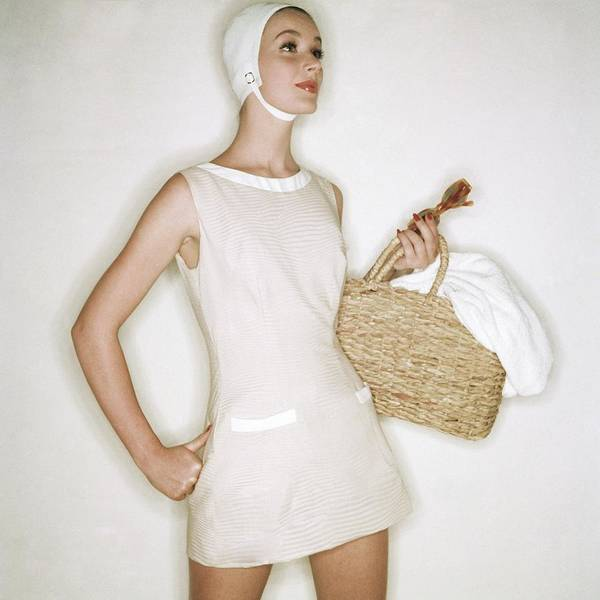 Towel Photograph - A Model Wearing A Carolyn Schnurer Bathing Suit by Clifford Coffin