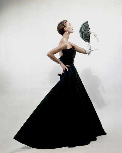 Formal Wear Photograph - A Model Wearing A Christian Dior Dress by Erwin Blumenfeld