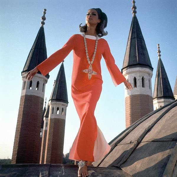 Architecture Photograph - A Model Wearing A Christian Dior Dress by Henry Clarke