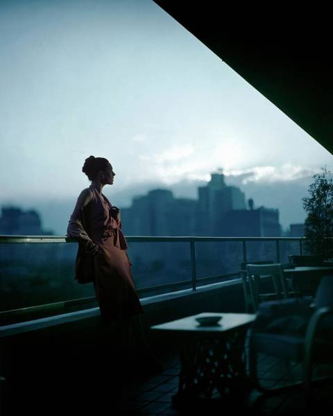 Urban Scene Photograph - A Model Wearing A Clare Potter Dress At Moma by Constantin Joffe