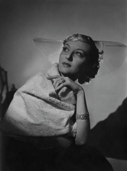 1936 Photograph - A Model Wearing A Coat And Glass Hat by Horst P. Horst