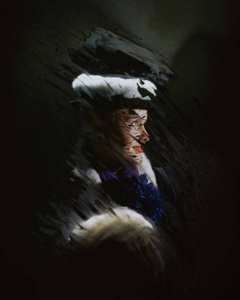 Blue Photograph - A Model Wearing A Coat And Hat by John Rawlings
