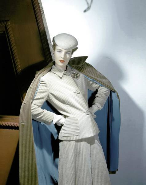 Beret Photograph - A Model Wearing A Corduroy Suit by Horst P. Horst