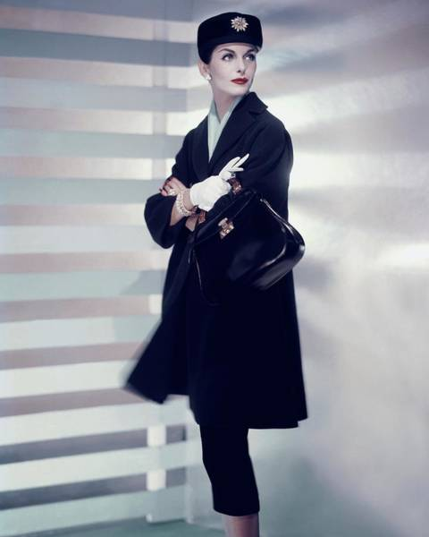 1956 Photograph - A Model Wearing A Designer Coat by Horst P. Horst