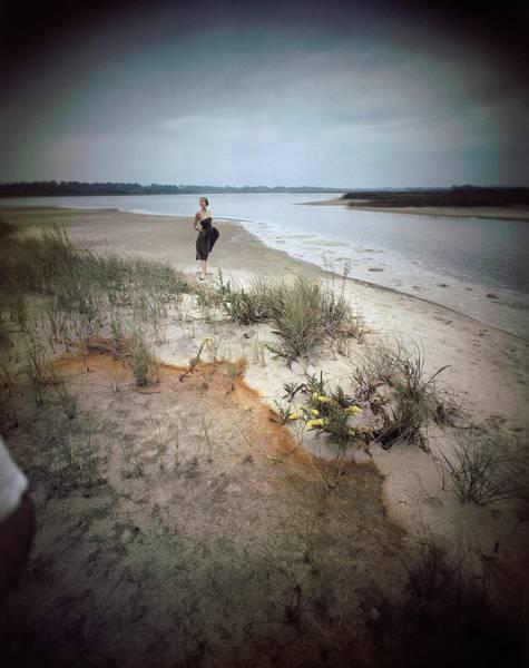 Landscape Photograph - A Model Wearing A Dress On A Beach by Serge Balkin