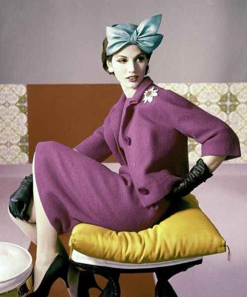Furniture Photograph - A Model Wearing A Dress Suit by Horst P. Horst