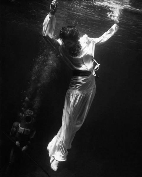 Underwater Photograph - A Model Wearing A Dress Underwater by Toni Frissell