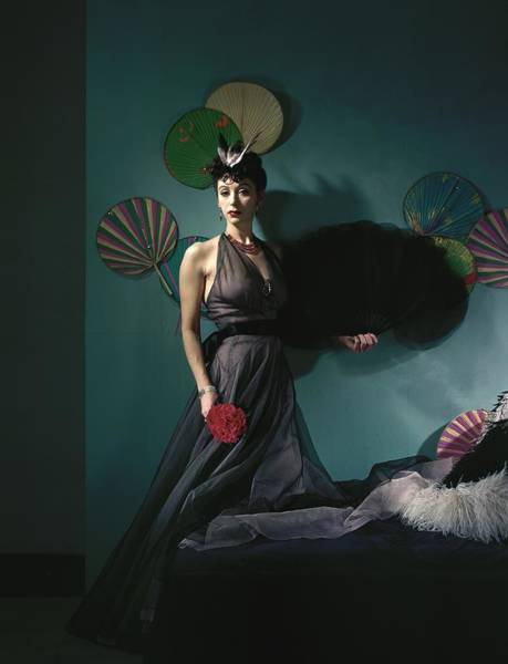 Bird Photograph - A Model Wearing A Dress With Fans by Horst P. Horst