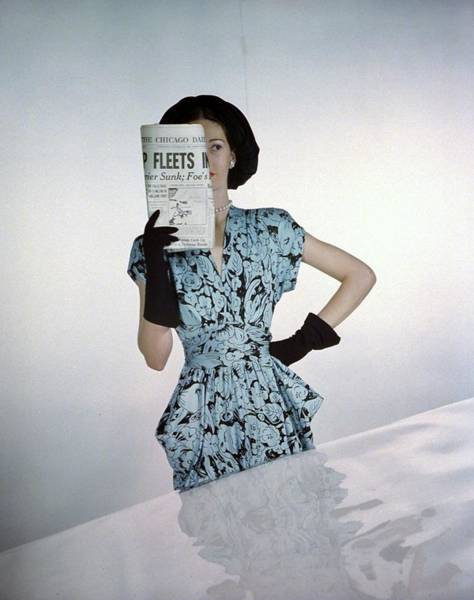 1945 Photograph - A Model Wearing A Floral Blue Dress by Constantin Joffe