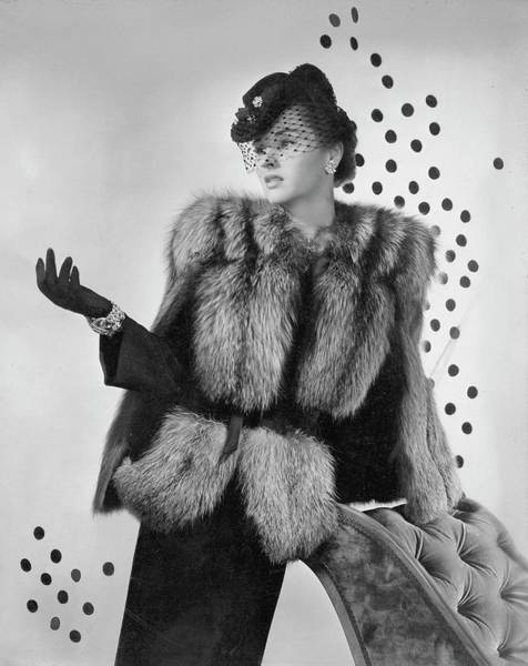 1942 Photograph - A Model Wearing A Fox Fur Jacket by Horst P. Horst