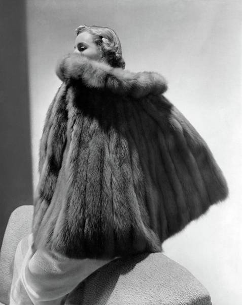 Photograph - A Model Wearing A Fur Cape by Horst P. Horst