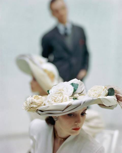 Photograph - A Model Wearing A Hat Decorated With Flowers by John Rawlings