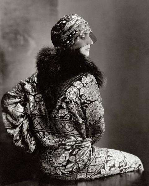 Glamour Photograph - A Model Wearing A Headdress And Brocade Coat by Edward Steichen