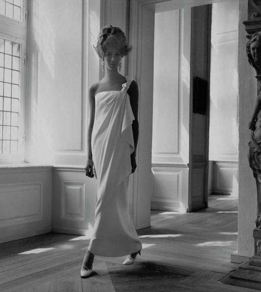 People Walking Photograph - A Model Wearing A Jean Louis Gown by Horst P. Horst