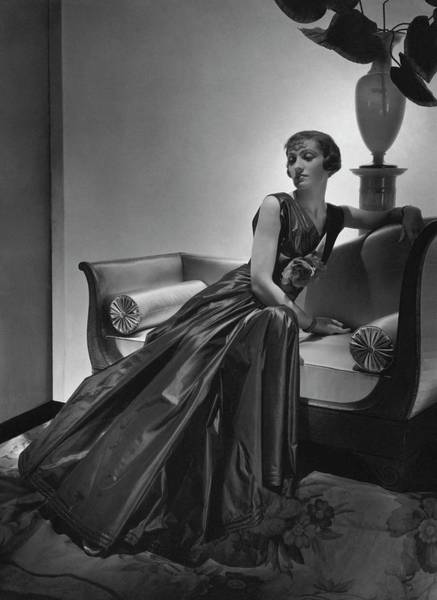Furniture Photograph - A Model Wearing A Maggy Rouff Dress by Horst P. Horst