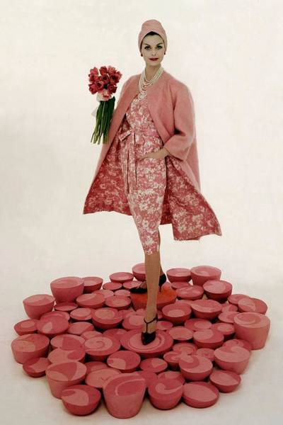 Floral Photograph - A Model Wearing A Matching Pink Outfit Holding by William Bell