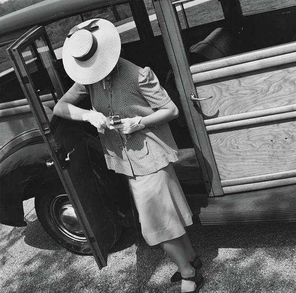 Auto Photograph - A Model Wearing A Maternity Suit by Toni Frissell