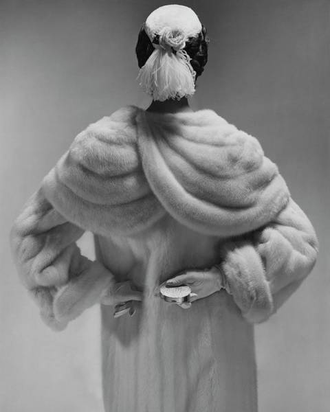 Glamour Photograph - A Model Wearing A Mink Coat by Erwin Blumenfeld