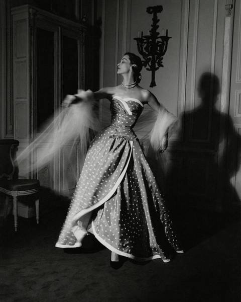 Evening Photograph - A Model Wearing A Polka Dot Dress by John Rawlings