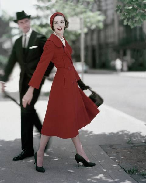 Urban Scene Photograph - A Model Wearing A Red Coat by Karen Radkai