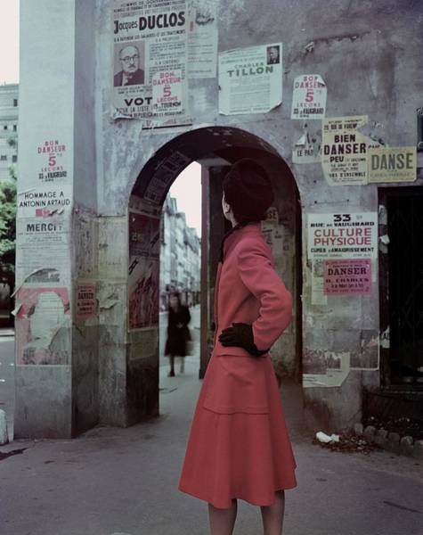 Photograph - A Model Wearing A Red Coat On A Street In Paris by John Rawlings