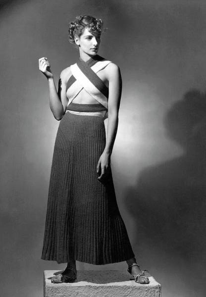 Photograph - A Model Wearing A Ribbed Knit Dress by Horst P. Horst