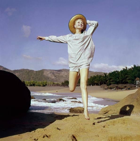 Wall Art - Photograph - A Model Wearing A Smock Top And Matching Shorts by Sante Forlano