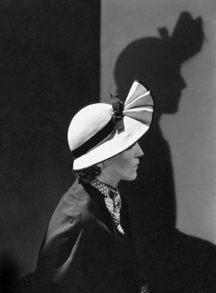 Sun Hat Photograph - A Model Wearing A Straw Hat by George Hoyningen-Huene