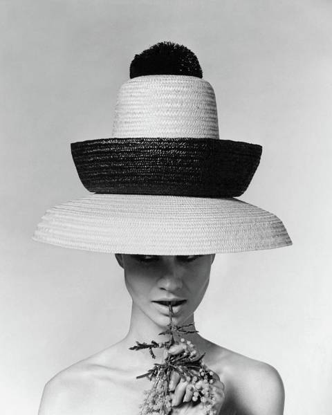 Model Photograph - A Model Wearing A Sun Hat by Karen Radkai