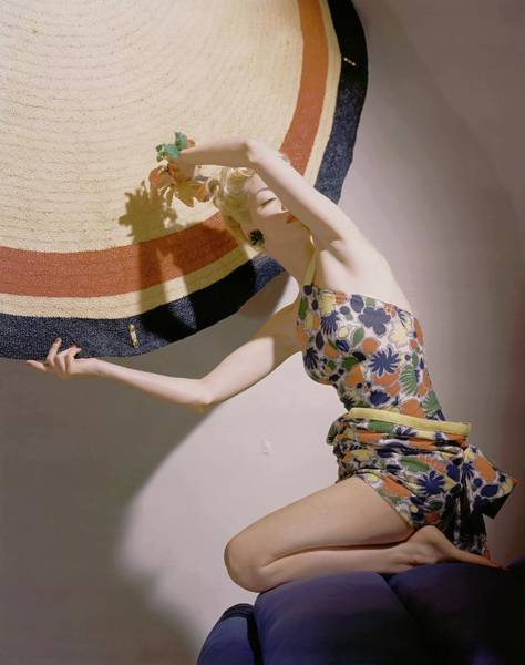 Sports Photograph - A Model Wearing A Swimsuit And Holding An by Horst P. Horst