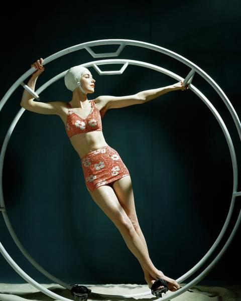 1942 Photograph - A Model Wearing A Swimsuit In An Exercise Ring by John Rawlings