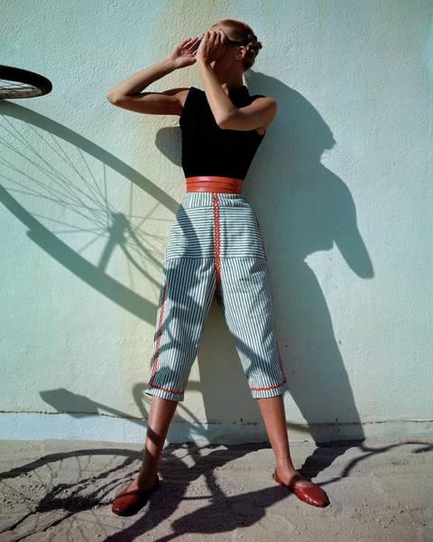 To Photograph - A Model Wearing A Turtleneck And Capri Pants by Serge Balkin