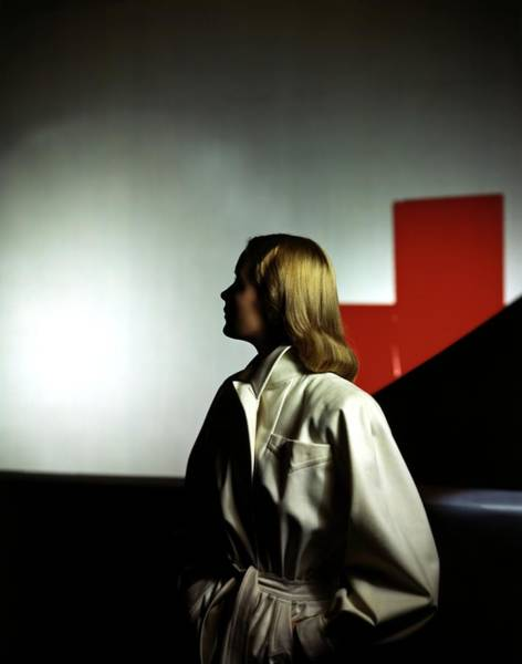 Coat Photograph - A Model Wearing A White Coat by Horst P. Horst