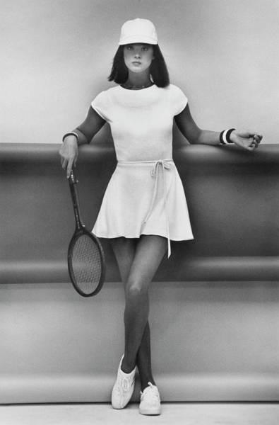Knit Hat Photograph - A Model Wearing A Wrap Dress And Cap by Albert Watson