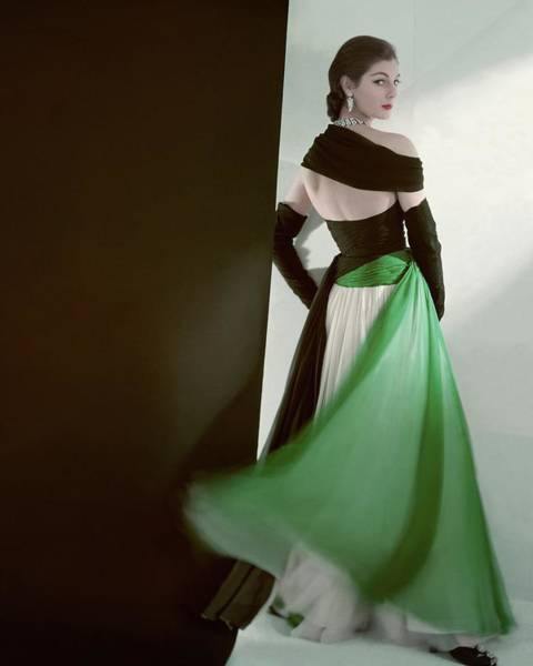 Evening Photograph - A Model Wearing An Evening Gown by Horst P. Horst