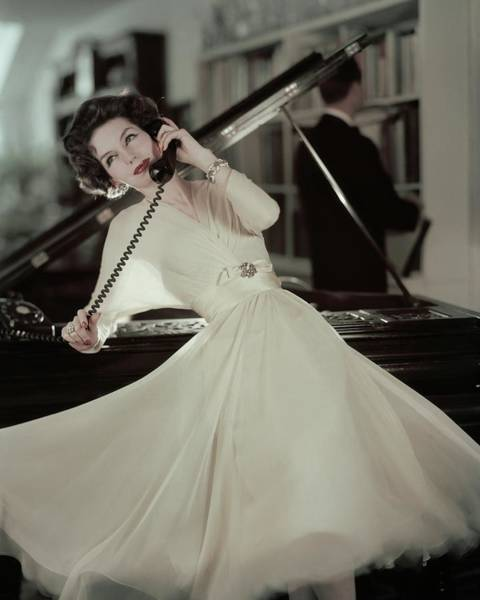Musical Instrument Photograph - A Model Wearing An Evening Gown Leaning by Karen Radkai