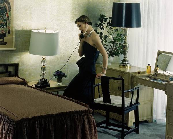 Telephone Receiver Photograph - A Model Wearing An Evening Gown On The Telephone by Herbert Matter